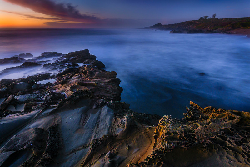 """Edge of the World""  Northern California Coastline at Sunset, Bean Hollow State Beach Tafoni.  This seascape was captured along the Northern California coastline near Half Moon Bay and Bean Hollow State Beach. These Tafoni rock formations are just amazing as they twist and turn with pockets that look like brains. This is a 30 second exposure where the water has turned soft and silky with the sun setting in the background. This image spoke to me as it felt like the edge of the world with the ocean just touching it. This is a re-process of the image that I really liked and I brought out the tones of the sunset and shadows in the rocks. Let me know what you think! Thanks! John    Copyright John Harrison Photography — in Half Moon Bay, California"