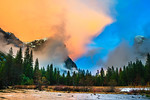 """Winter Sunset at Valley View in Yosemite National Park""  I captured this image in February a few years ago in similar conditions as the weather is there currently in Yosemite - rain and clouds down in the valley with snow at the higher elevations.  This day we headed out thinking that it was raining and no chance of a sunset.  As we headed out the clouds started to clear with the sun poking through.  Each minute just started to get better and better!   Like a symphony unfolding in mother nature's concert hall - the drama and excitement changing each minute in Yosemite. El Capitan totally covered in clouds one minute, wide open the next.  No sun one minute, orange, pink and blue the next!   What an amazing time.  Hoping to head up to Yosemite and catch another clearing storm!  The great thing about taking photographs in Yosemite is the weather, clouds and lighting creates totally conditions so that image you capture won't look like anyone else!  Go to Yosemite and take lots of pictures!"