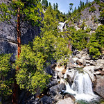 """Cascades Creek Waterfall in Spring""  This is the Cascades Waterfall on the upper part of Cascade creek. Yosemite National Park. The spring runoff was just picking up as it was 70 degrees down in the Yosemite Valley. I love the red bark on the trees with the bright green leaves and pines! Just a nice scene where you want to park a chair and listen to the waterfalls."
