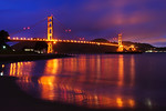The Golden Gate after the Storm in San Francisco. It was pouring while I went up to San Francisco to put up a new exhibit at Planet Granite Climbing Gym in the Presidio. When I had finished setting up the exhibit, I went out and there was a nice calm on the bay. High clouds and the colorful dusk glowing off the clouds above the bay. This is a 4 shot panorama stitched in Photoshop CS4. Obviously I used a tripod to capture the water flowing in the bay (30 seconds each at F11, ISO 400. Noise reduction applied.