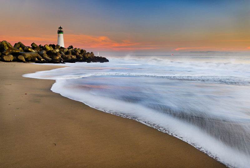 """""""Sunset at Seabright Beach in Santa Cruz"""" Walton Lighthouse in the background from our winter trip to the beach this past weekend. Just some nice even lighting with a little glow and the longer exposure with the waves along the shoreline."""