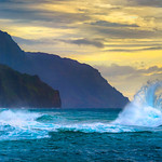 """Tropical Waves in Kauai at Sunset"" Shooting off the end of Kauai at Ke'e Beach on the Napali Coast with some amazing waves!  We were having fun but keeping a close eye out on the big waves. The depth of those rugged Kauai cliffs extends for miles along the Napali Coast with the splash crashing along!  The waves crash along the shore and then head back out and crash together creating those backwash waves!"