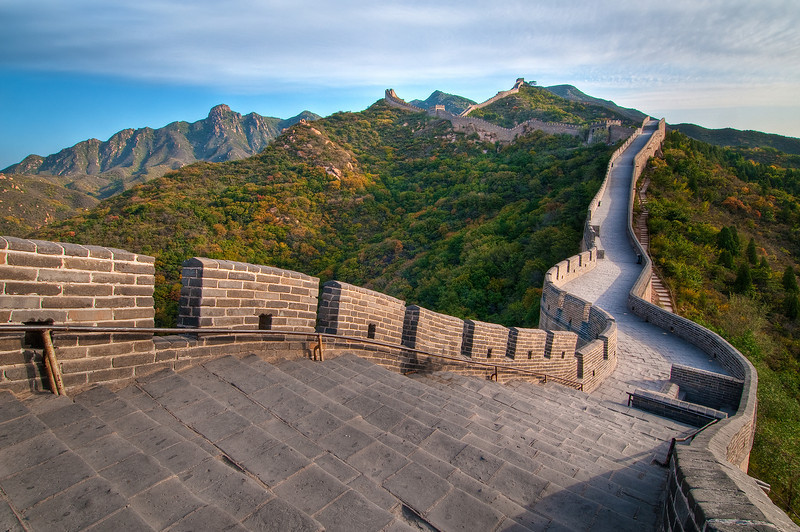 All Quiet on The Great Wall.  Badaling Section.  For my visit to Beijing, I had a fantastic guide who managed to get me access to the Great Wall BEFORE it opened to the public! He asked me why I wanted to leave so early?! Now he knows why! This is one of the most visited and popular sections of the wall to visit and I am glad I was able to enjoy it with NO ONE THERE! (Sprinting to the top with a 30 pound camera pack was a little challenge!) I have another image 180 degrees the other direction also with no people - it is amazing how far the wall extends.  This is the way a treasure like this is supposed to be enjoyed!