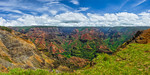 """Waimea Canyon Panorama"" Kauai is one of our favorite places to visit but I never got around to making this panorama! This is on the western side of Kauai at Waimea Canyon State Park. The views are incredible and some call it the Grand Canyon of the Pacific. Add this to your list of places to visit. We went up a little further towards the top with the views along the Napali Coast and were totally fogged in! Lucky to catch these nice clouds and blue skies! Enjoy!   Copyright John Harrison Photography   — at Waimea Canyon Lookout."
