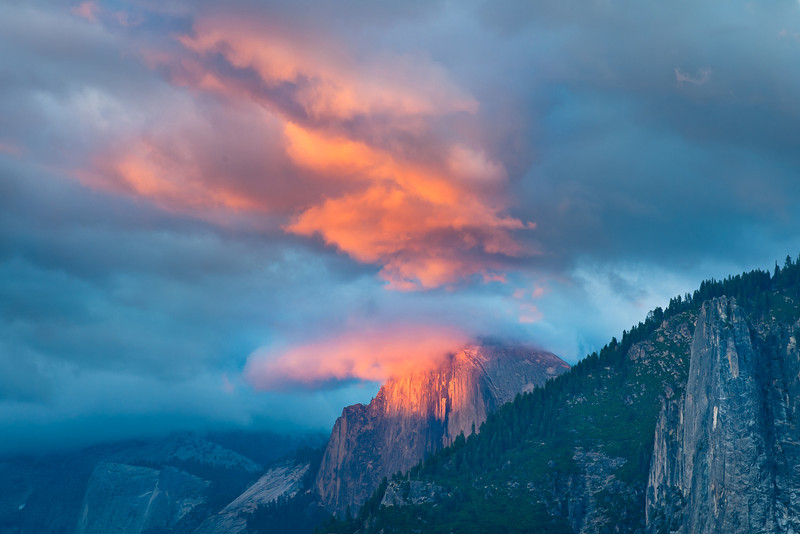 """""""Summer Sunset on Half Dome""""  As the sun started sinking the clouds lit up with a dramatic sunset on Half Dome and above Half Dome.  Another incredible way to enjoy Yosemite National Park"""