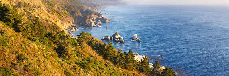 """""""Big Sur Coastline at Sunset"""" Printing a 30x40 of this for a collector and thought I would share!  Driving along Highway 1 down to Big Sur gives some breathtaking vistas!!  Make sure you pull off at every spot as the coastline continues to change.  If you look down at the waterline there is a arch that the water flows through. Winter days lets you get nice clear views without the fogs and are one of my favorite times to go - especially with crazy war weather we are having this January in Northern California. Love the amazing hills, rocks and trees down to the ocean.  This can be made into a 1:2 and 1:3 ratio Panorama which looks fantastic on your walls above the couch, fireplace or in a conference room or office!  Let me know if you like it! This is a 1:3 ratio panorama of the full image."""