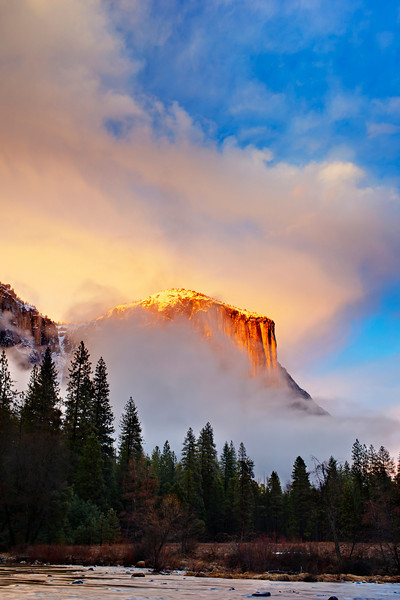 """Clearing Storm on El Capitan at Sunset""   We almost were headed to the bar with cloudy and rainy skies when I was up for the Yosemite Renaissance Gallery reception. I talked my friend into driving to the other side of Yosemite valley ""just in case!"" Sure enough, one blue spot lead to another and THIS was in front of us!  The skies opened up with patches of blue and billowing clouds rolling around El Capitan.  The sun was glowing on the top of El Cap with the snow capped cliffs highlighted. What an amazing sight!(Michael Frye has a blogpost titled ""The One That Got Away"") - I am sure lucky that I was there and able to get this one!  Maybe my blog-post should be ""The One That ALMOST got Away - but didn't!""  Winter in Yosemite National Park is an amazing place!"