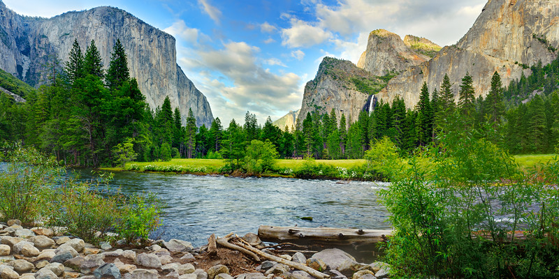 """""""Gates of the Valley in Spring""""  Valley View, Yosemite National Park.  This is the last stop before you leave the Yosemite Valley area and I stop every time!  Awesome views of El Capitain and Bridalviel Falls while the Merced River is flowing by.  Just surround by a peaceful setting with a few clouds and green all around."""