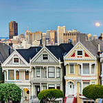7 Painted Ladies in San Francisco at Sunset with the Full Moon rising in the background. 7 Painted Ladies at Sunset with a view of Downtown San Francisco. Located in Alamo Square, the Victorian houses on Steiner Street. This is one of San Francisco's most photographed landmarks, yet I still run into people everyday who have never been here!   This is a 1:2 ratio panorama and can be made as a 1:3 Panorama as well.