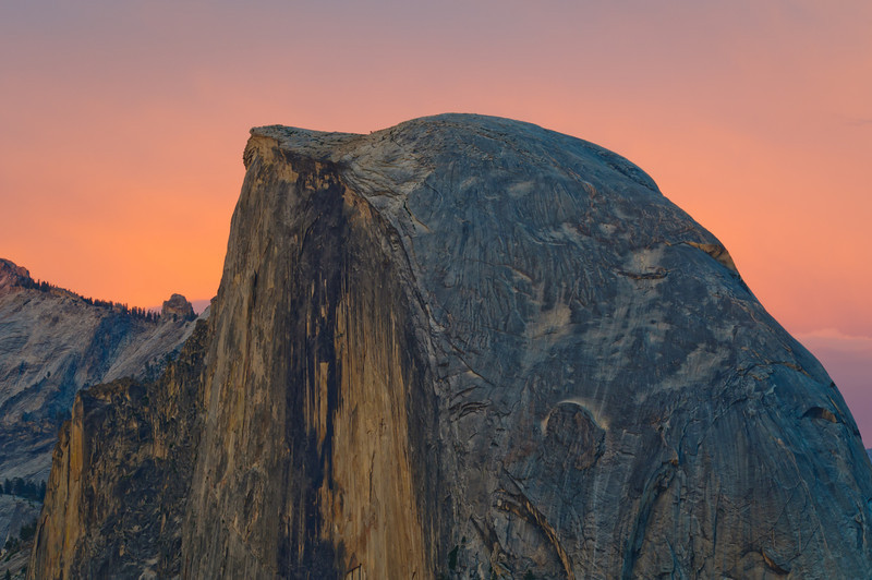 Half Dome at Dusk in Yosemite National Park.   A beautiful capture of Half Dome with a warm summer glow around Half Dome.  This is taken from the Glacier Point lookout.