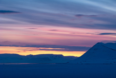 Dawn over Isfjorden, Svalbard. Taken from Longyear airport. It is April, and the long polar night is over, and it is never gets darker than twilight. Soon the sun will stay above the horizon around the clock.