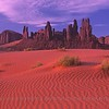 Monument Valley with wind-swept sands.