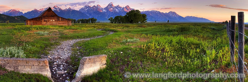 "Morman Row Sunrise - Grand Teton National Park, Wyoming  The light of the rising sun illuminates the peaks of the Teton Mountains in the distance.  This famous scene has been captured by countless photographers over the years.  I chose to capture a slightly different vantage point by including the small rock bed and fence on the right.  I bracketted each exposure by +/- 1 EV, and later combined the images in Photomatix to create a tone mapped HDR.  I stitched 10 source images using Panorama Factory to create this image.  I used my Canon 10D and 20mm lens to shoot this. <BR><BR>Want to buy a print of this image?  Click <a href=""http://www.langfordphotography.com/For-Sale/Landscapes/306073_Stwqtj#!i=1018074417&k=9gtkP"">Here</a>!"