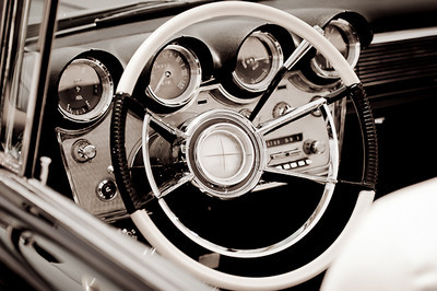 Black and white close up of the wheel and dashboard of a Lincoln Continental  by Alex Kaplan, photographer http://www.alexkaplanphoto.com