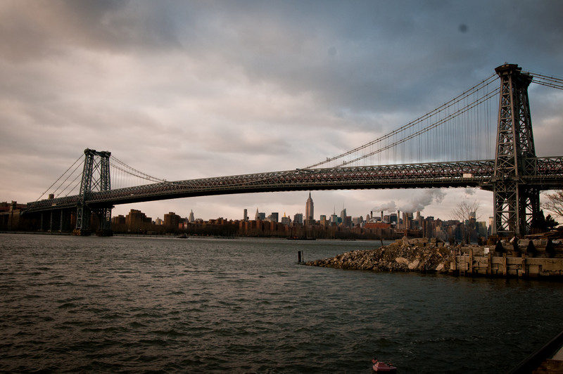 View of George Washington Bridge from below with the New York City skyline and a cloudy sky in the background by Alex Kaplan, photographer http://www.alexkaplanphoto.com