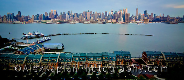 View from above of apartments with blue rooftops over looking the water with boats and docks with the city skyline across the water by Alex Kaplan, photographer http://www.alexkaplanphoto.com