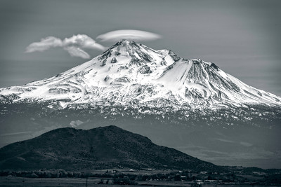 Shasta in the Afternoon.  The remnants of a lenticular cloud hovers over the peak of Mt Shasta.