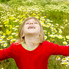 blond girl open arms spring meadow daisy flowers