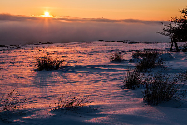 Snow at sunset with the clouds in the valley. Taken near Belthorn, Lancashire looking towards Jubilee Tower, Darwen
