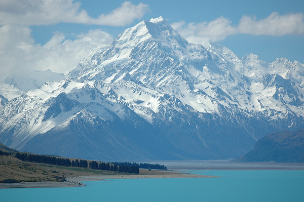 Mount Cook after a beautiful snow fall in the summer.  Lake Pukakai in the foreground.