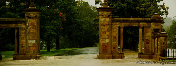 Flood water rushes out of the cemetery gates during hurricane Irene