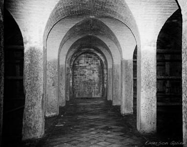 Dark abandoned mausoleum hallway