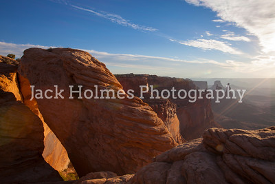 Mesa Arch as the sun peaks thru the clouds.