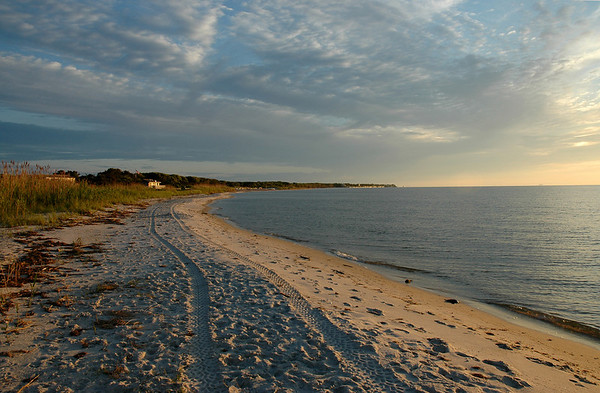 Barrett Beach, Bay Side of Fire Island, Great South Bay<br /> Empty beach at sunset, tire tracks in the sand, distant house on the shore, reflecting the sunset.