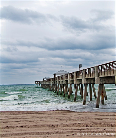 Juno Beach Pier with clouds