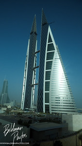 Bahrain World Trade Center - a very cool building which powers itself with three big propellers in between the two buildings. More info can be found here - Bahrain World Trade Center - Official Site