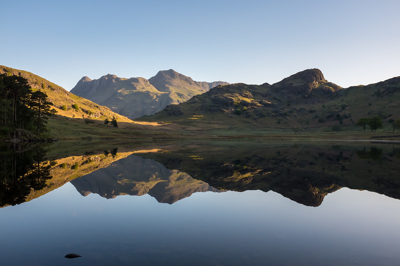 Dawn over Blea Tarn and the Langdale Pikes, Cumbria, UK