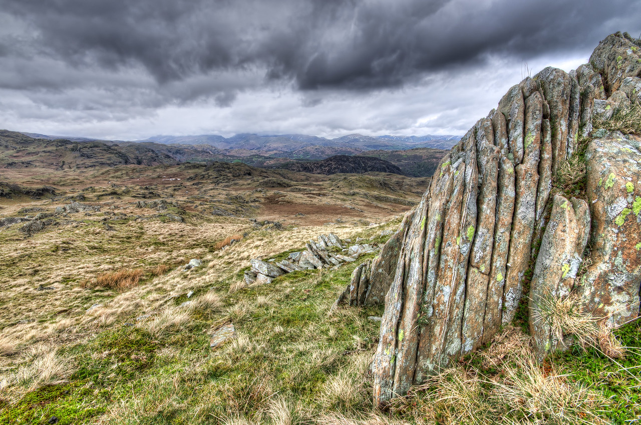 Yewdale Crag over Coniston, the view looks out over the Langdales and Fairfield. Cumbria, UK