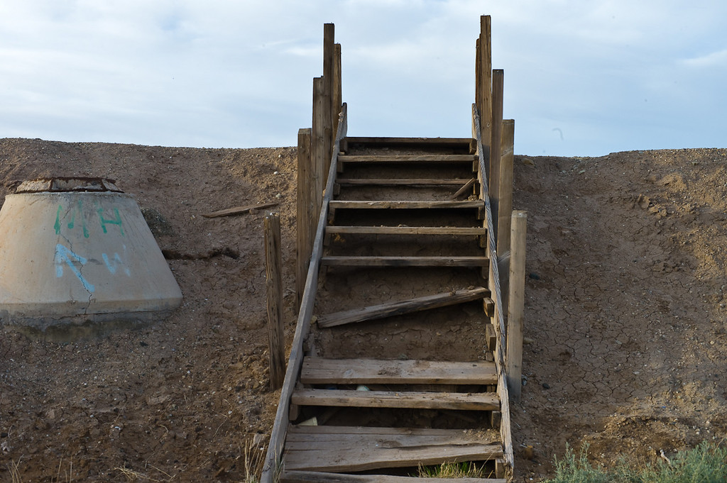 The stairs to the eastern shore. I wish now we would have climbed over. There are some of the abandoned trailers and houses from the flood on this side but even the dogs seemed not too friendly in Bombay Beach.