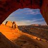 Delciate Arch Through Silhoutted Arch