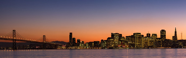 The Bay Bridge and skyline of downtown San Francisco, San Francisco, California, USA.