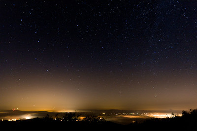 Santa Clara Valley towns under a thin veil of fog at night, California, USA.