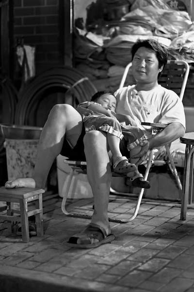 64) 	Man and Baby