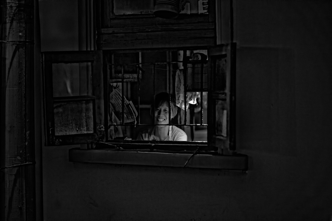 74) Woman in Window