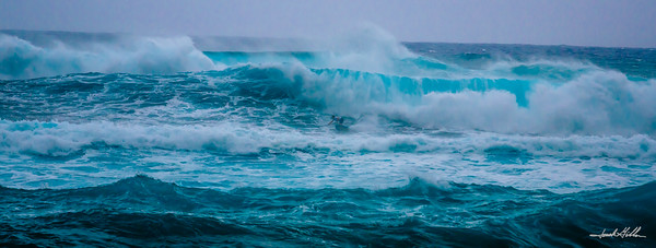 Caugh in a set of big waves