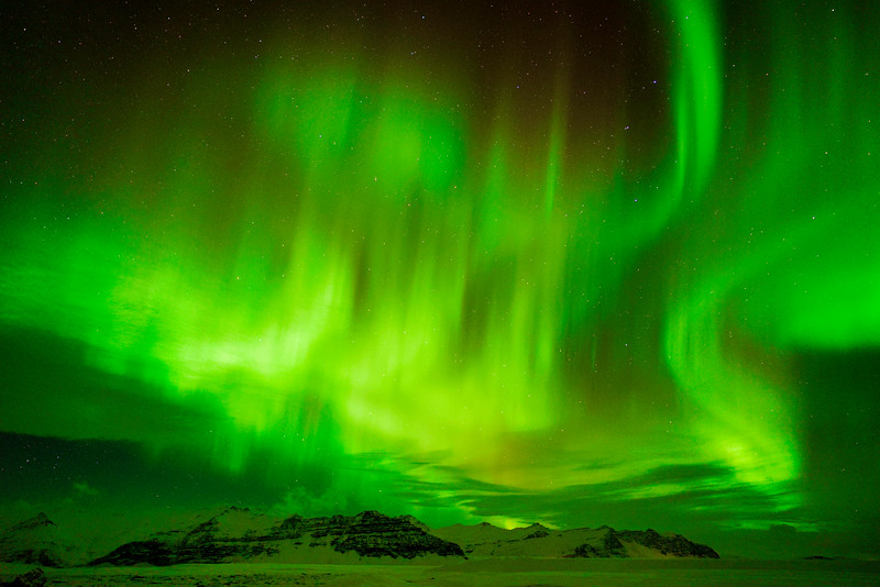 Northern Lights and Glacial Mountains