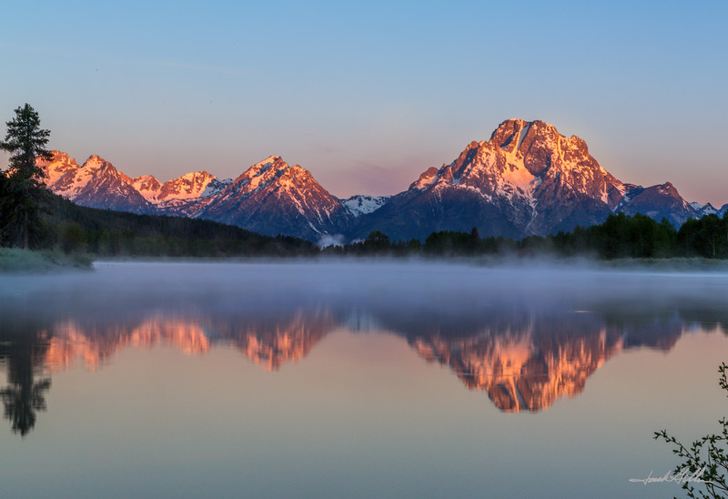 Morning mist at sunrise Oxbow Bend