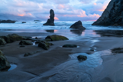 Sunset-Lit Clouds and Sea Stacks