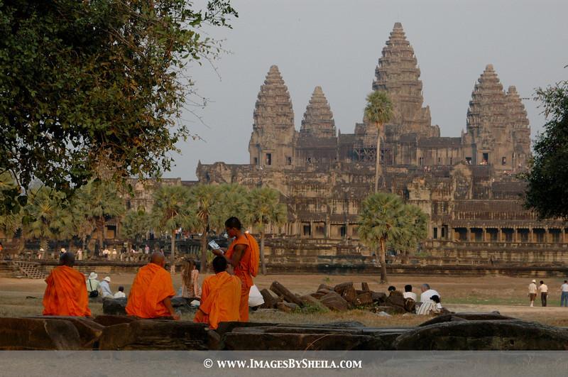 Monks at rest overlooking Angkot Wat - Cambodia