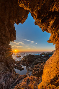 Setting Sun and Sea Cave