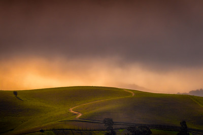 Winding Dirt Road Into Storm Clouds, San Benito County, California