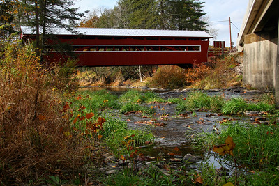 IMG#2594 Huntington Creek runs under the East and West Paden covered twin bridges.  Built in 1884 by W.C. Pennington for $720.00, they are located in Fishing CreekTownship, Columbia county, Pennsylvania. October 2009