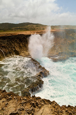 IMG#9154  Western end of Aruba's wild surf 5/19/09...constant punishment to the rocks surrounding it.