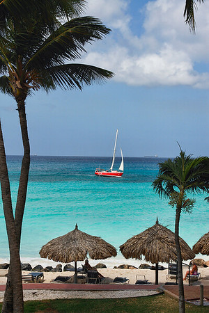 Colorful sailboat cruises the Beach at Casa Del Mar...Aruba 2014
