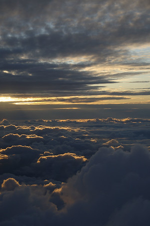 IMG#1501 Cushions of Clouds rising with the sun at 25,000 feet