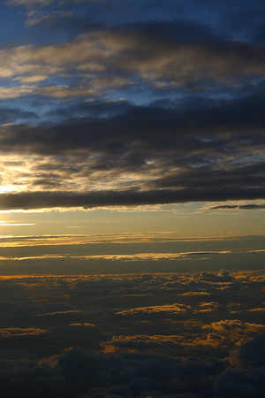 IMG#1507 Sunrise peeking out above 25,000 feet